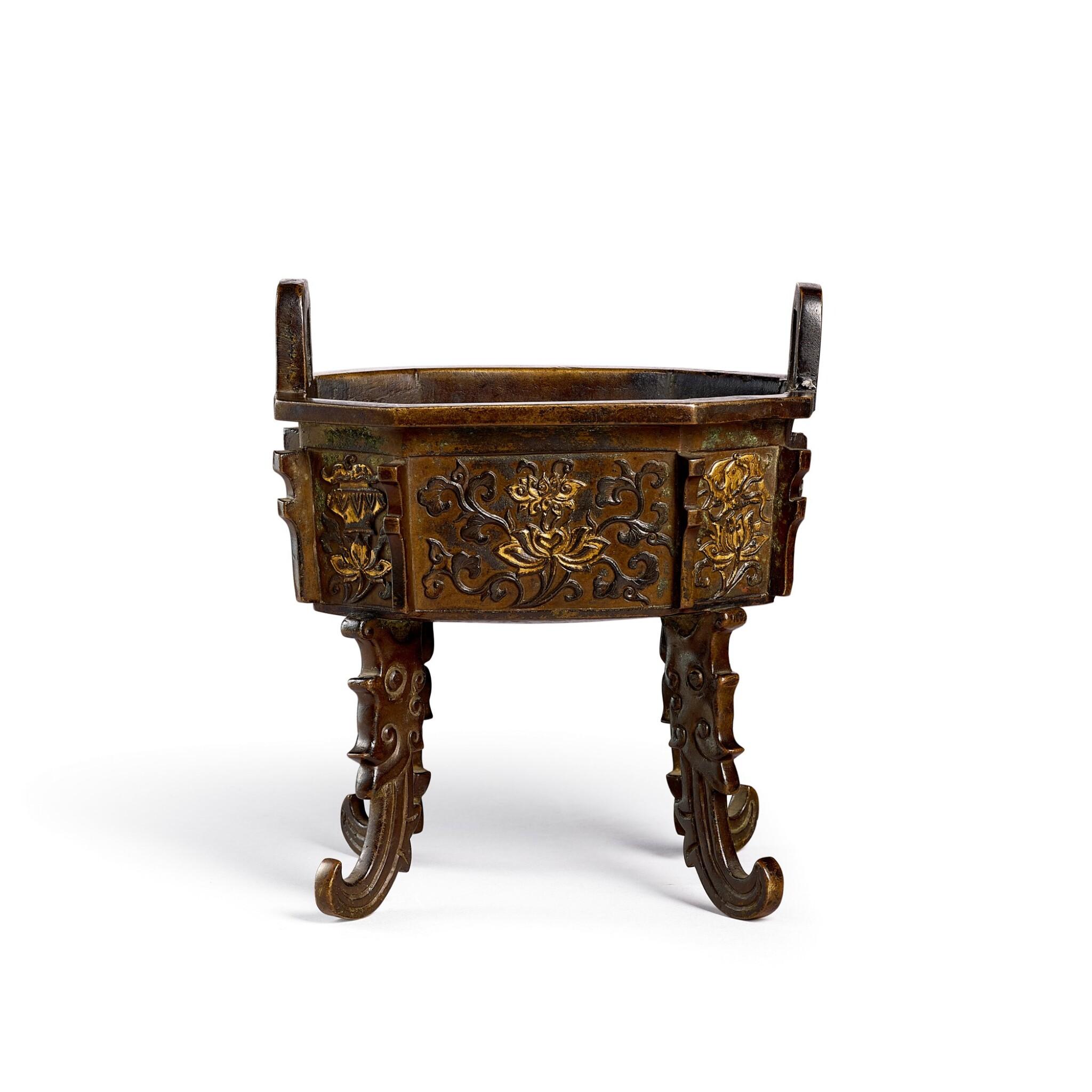 View full screen - View 1 of Lot 3676. A parcel-gilt bronze 'bajixiang' incense burner, ding Ming dynasty, Xuande mark   明 局部鎏金銅八吉祥衝天耳鼎式爐 《大明宣德年製》仿款.