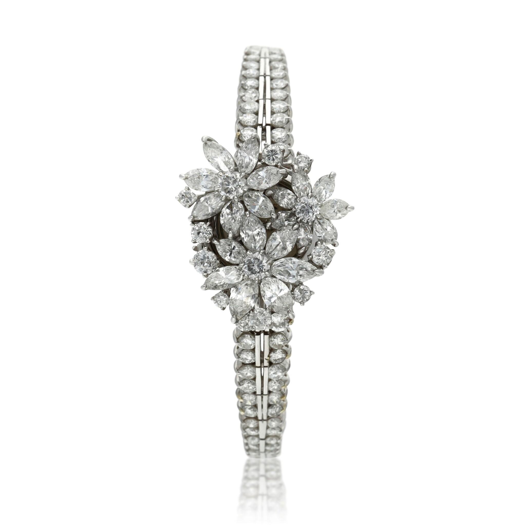 View full screen - View 1 of Lot 96. A lady's platinum diamond set cocktail wristwatch on diamond link bracelet, Circa 1960.