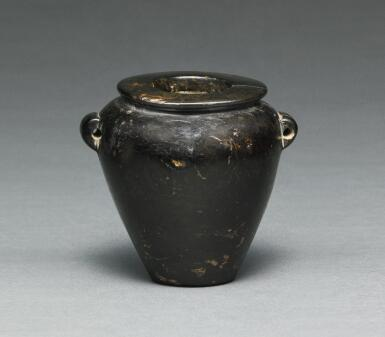AN EGYPTIAN BROWN AND BLACK SERPENTINE JAR, LATE PREDYNASTIC PERIOD, CIRCA 3500-3200 B.C.