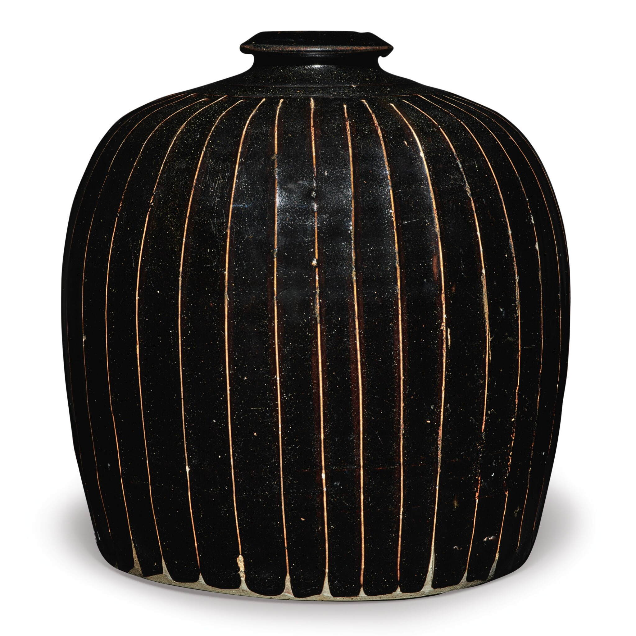View full screen - View 1 of Lot 128. A black-glazed 'ribbed' 'tulu' vase, Northern Song / Jin dynasty | 北宋 / 金 黑釉棱線紋小口瓶.