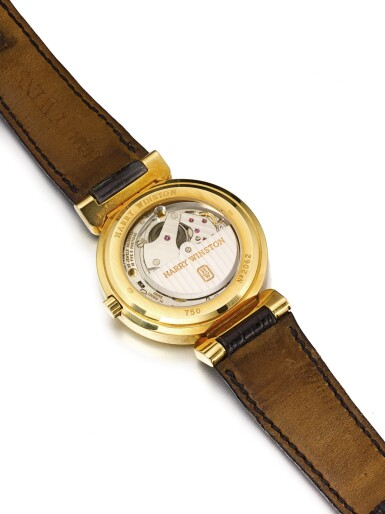 HARRY WINSTON   A YELLOW GOLD AUTOMATIC RETROGRADE PERPETUAL CALENDAR WRISTWATCH WITH MOON PHASES CIRCA 2005