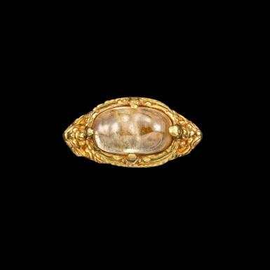 View 1. Thumbnail of Lot 1028. A gold and cabochon crystal repoussé ring Khmer, 8th - 11th century | 八至十一世紀 高棉 金嵌水晶戒指.