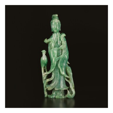 AN APPLE-GREEN JADEITE FIGURE OF A STANDING MEIREN, LATE QING DYNASTY