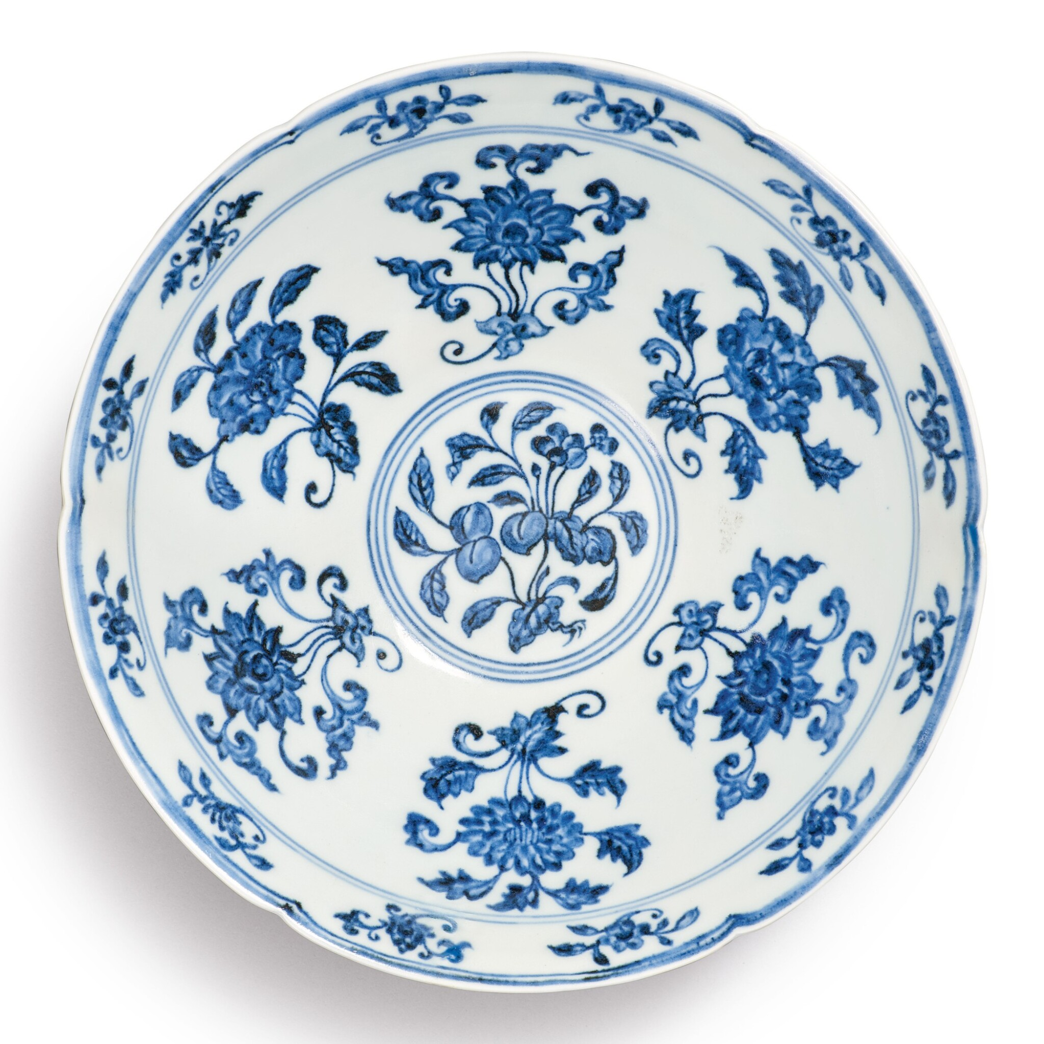 View full screen - View 1 of Lot 131. A finely painted blue and white lobed 'fruit and flower' bowl, Xuande mark and period | 明宣德 青花折枝花果紋葵口碗  《大明宣德年製》款.