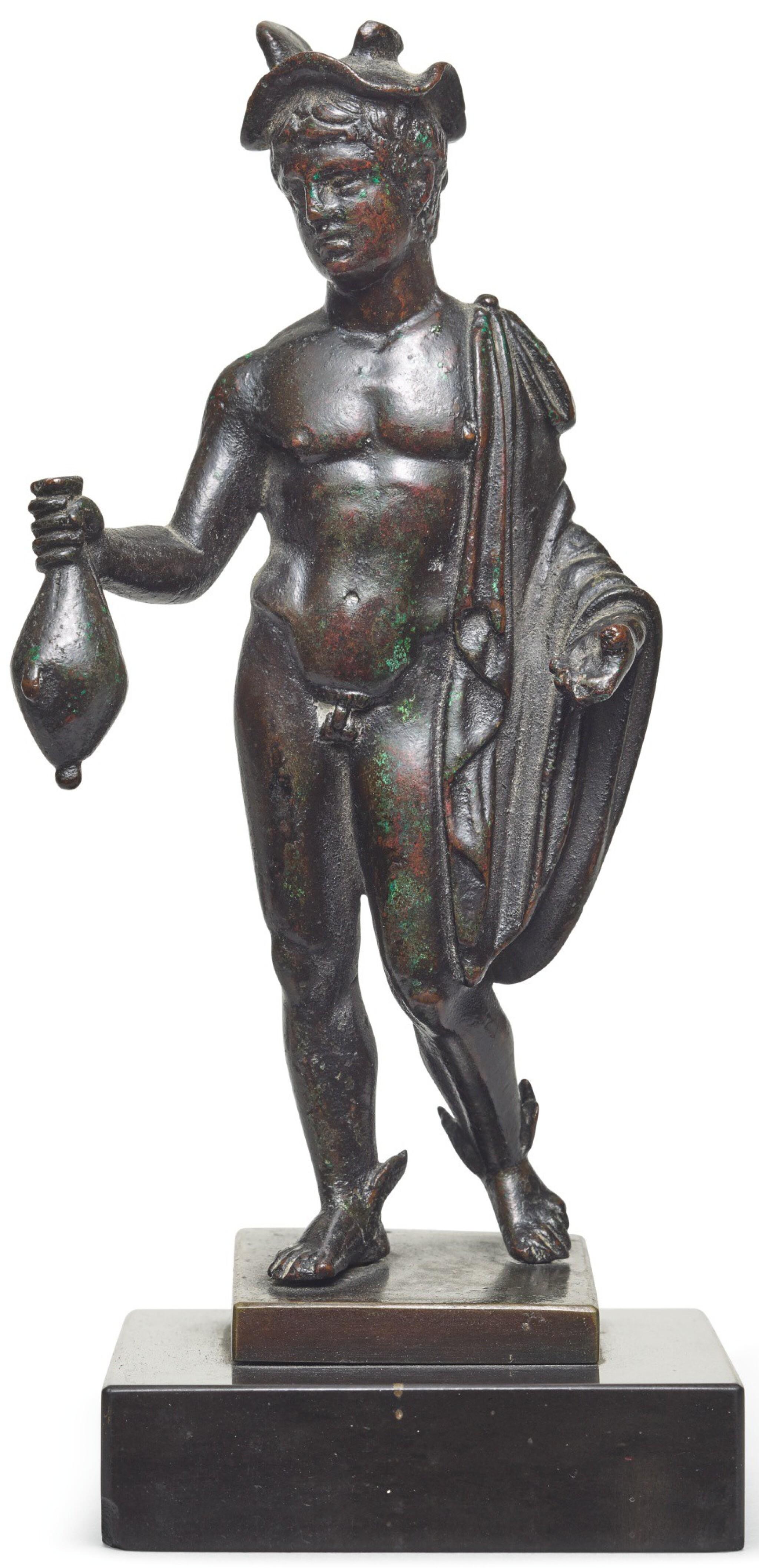 View full screen - View 1 of Lot 124. A Roman Bronze Figure of Hermes, circa 2nd Century A.D..