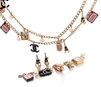 Collection of faux pearl and 'Paris Souvenirs' charm costume jewelry