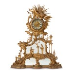 A GEORGE III REVIVAL GILTWOOD OVERMANTEL MIRROR AND CLOCK AFTER A DESIGN BY THOMAS JOHNSON, SECOND HALF 19TH CENTURY