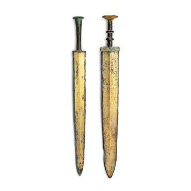 View 2. Thumbnail of Lot 22. Two archaic gilt-bronze swords (Jian), Warring States period - Western Han dynasty | 戰國至西漢 銅鎏金龍紋劍及銅鎏金劍.
