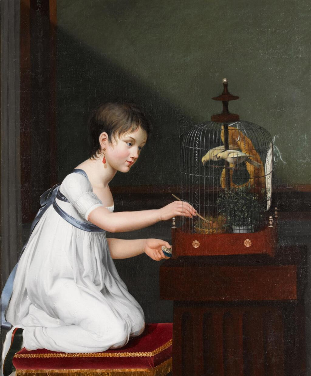 JEANNE ELISABETH CHAUDET | A young girl in a white dress with a green sash, kneeling by a bird cage while tending to her birds