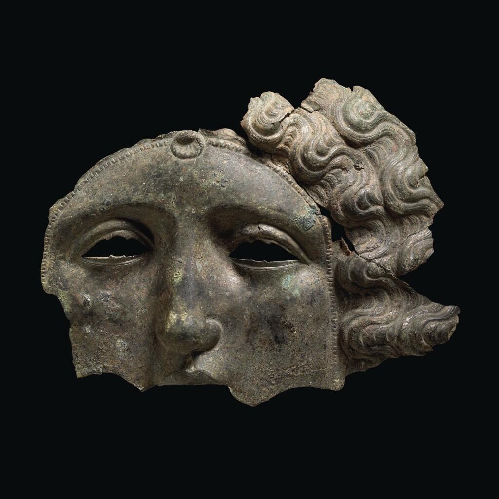 A FRAGMENTARY ROMAN BRONZE CAVALRY PARADE HELMET MASK, CIRCA LATE 2ND CENTURY A.D.