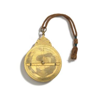 View 3. Thumbnail of Lot 67. A fine Safavid gilt-brass astrolabe made for Imam Mirza Razi al-Din Muhammad Husayni al-Mawsawi (d.1701), signed by Muhammad Husayn ibn Muhammad Baqir al-Yazdi, decorated by Muhammad Mahdi al-Yazdi, Persia, circa 1660.