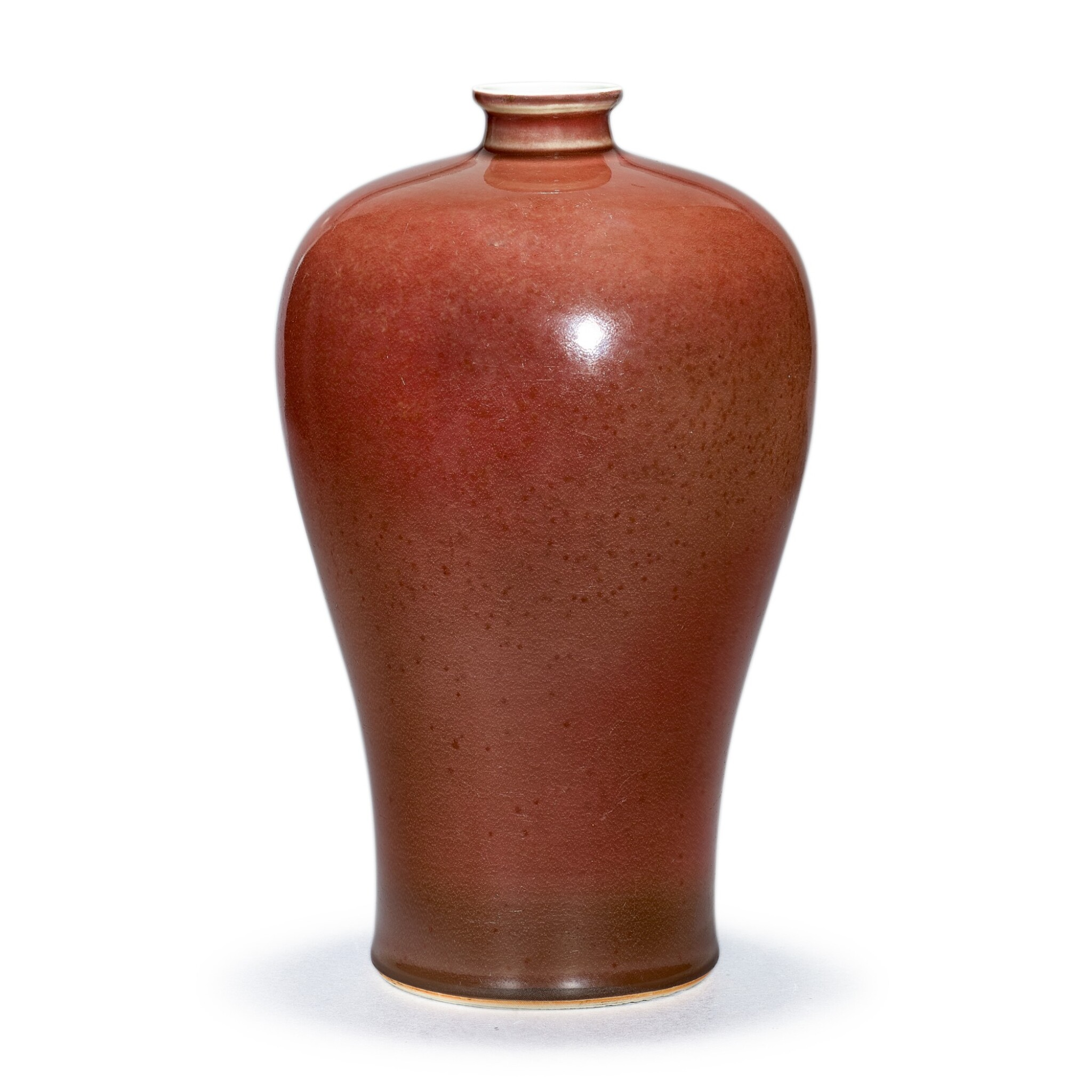 View 1 of Lot 120. A RARE COPPER-RED GLAZED MEIPING MARK AND PERIOD OF KANGXI | 清康熙 紅釉梅瓶 《大清康熙年製》款.