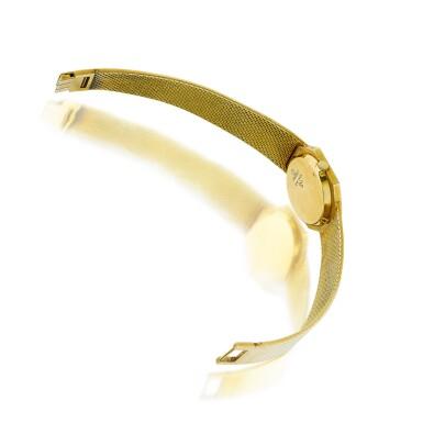 View 3. Thumbnail of Lot 74. Piaget | Montre de dame or et malachite | Lady's gold and malachite bracelet watch.