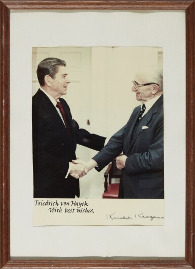 View 2. Thumbnail of Lot 19. RONALD REAGAN, SIGNED PHOTOGRAPH OF THE PRESIDENT AND HAYEK, [1983].