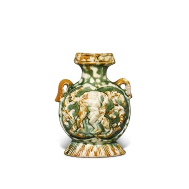 View 2. Thumbnail of Lot 171. A molded sancai-glazed pottery pilgrim's flask, Tang dynasty | 唐 三彩印樂舞圖扁壺.
