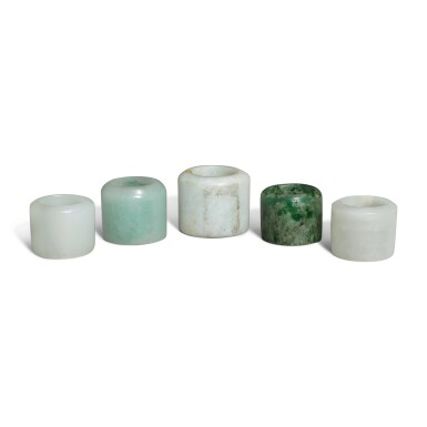 View 3. Thumbnail of Lot 163. Five jade and jadeite archer's rings, 19th / 20th century.