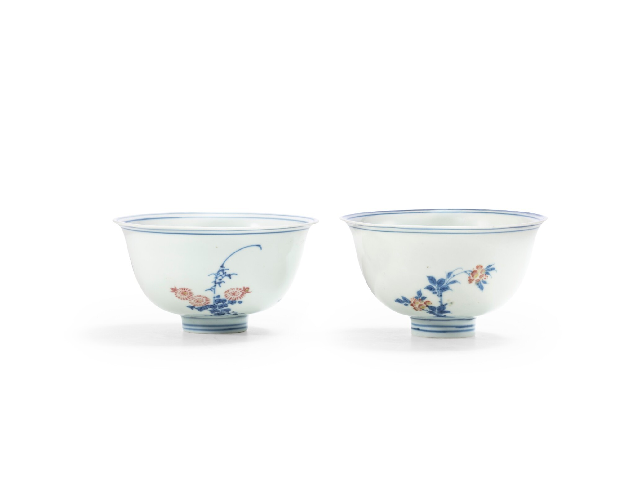 View full screen - View 1 of Lot 62. A pair of blue and white and underglaze red 'floral' bowls Qing dynasty, Kangxi period | 清康熙 青花釉裏紅花卉紋盌一對.