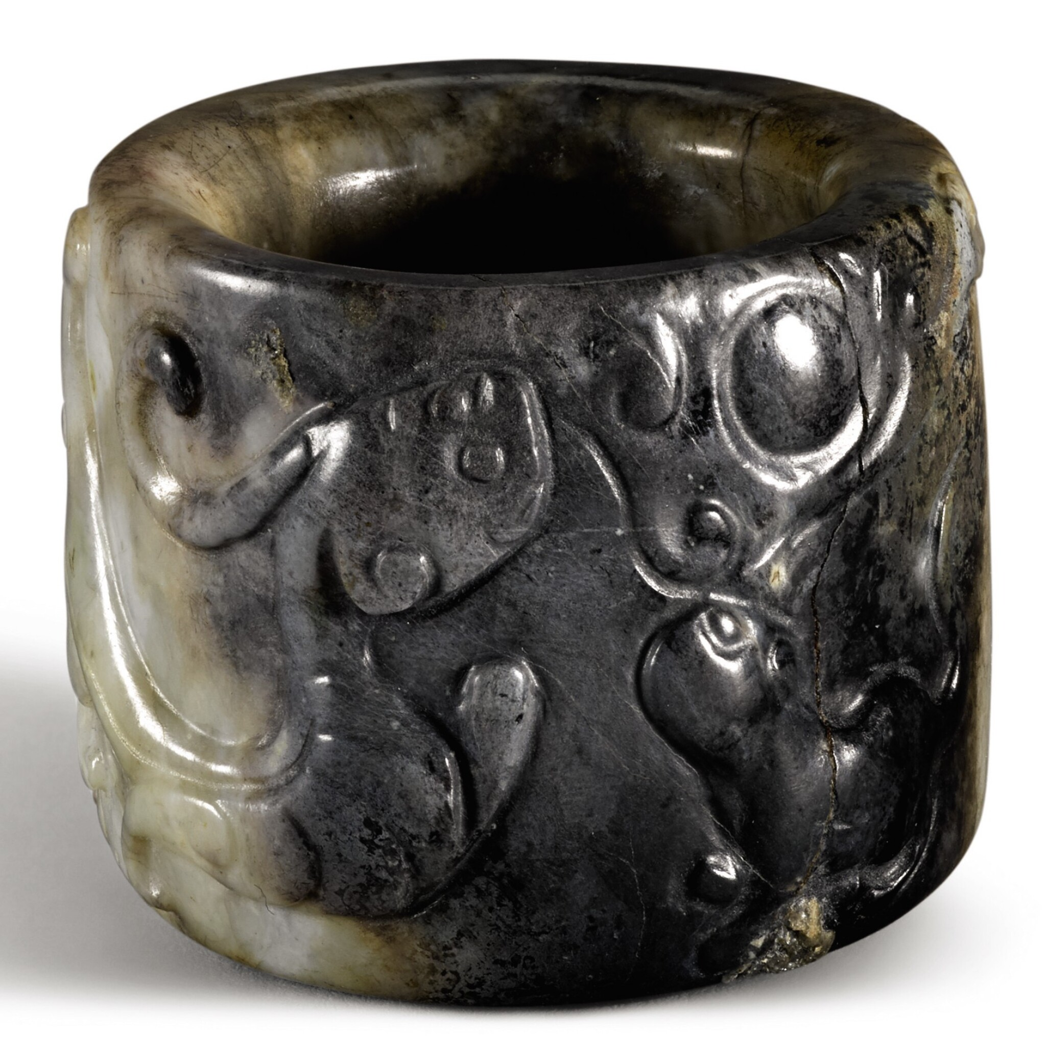 View full screen - View 1 of Lot 314. A MOTTLED GREY AND WHITE JADE THUMB RING QING DYNASTY, 19TH CENTURY | 清十九世紀 灰玉瑞獸紋扳指.