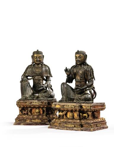 View 1. Thumbnail of Lot 14. IMPORTANTE ET TRÈS RARE PAIRE DE STATUETTES DE BODHISATTVA EN BRONZE PARTIELLEMENT DORÉ XIVE SIÈCLE | 十四世紀 鎏金銅菩蕯坐像一對 連   清十八世紀 漆金木雕須彌座一對| An important and very rare pair of parcel-gilt bronze figures of Bodhisattva, 14th century; together with a pair of lacquer-gilt thrones, Qing Dynasty, 18th century.