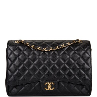View 1. Thumbnail of Lot 60. Chanel Quilted Maxi Classic Double Flap Bag of Black Caviar Leather with Gold Hardware.