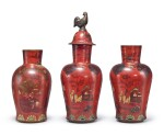 THREE BERLIN FAIENCE RED-LACQUERED VASES AND COVERS, 19TH CENTURY