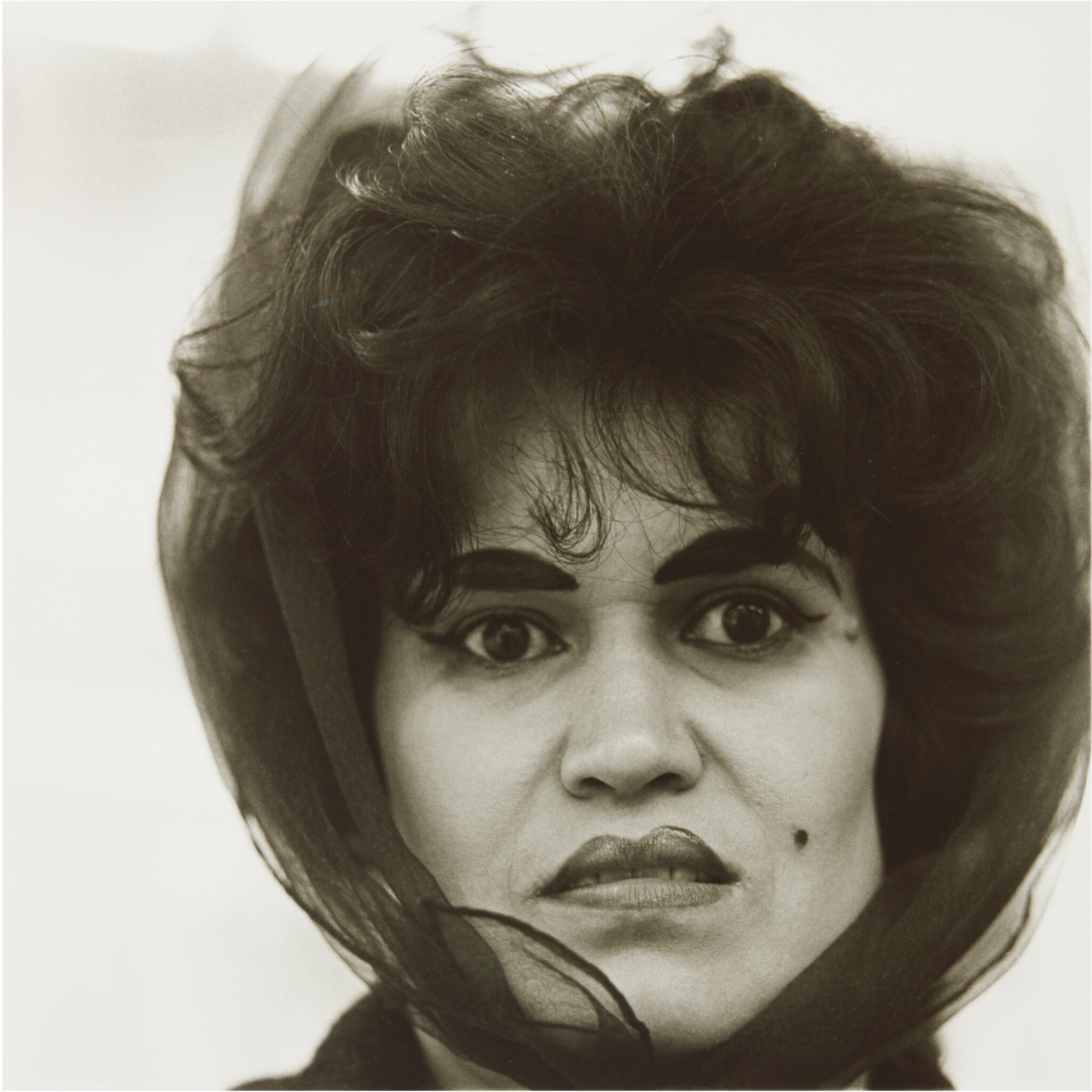 View full screen - View 1 of Lot 12. DIANE ARBUS | 'PUERTO RICAN WOMAN WITH A BEAUTY MARK, N. Y. C.'.