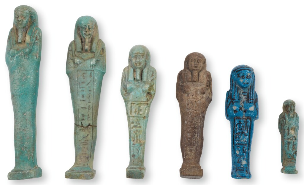 SIX EGYPTIAN GLAZED USHABTIS, 21ST-26TH DYNASTY, CIRCA 1075-525 B.C.