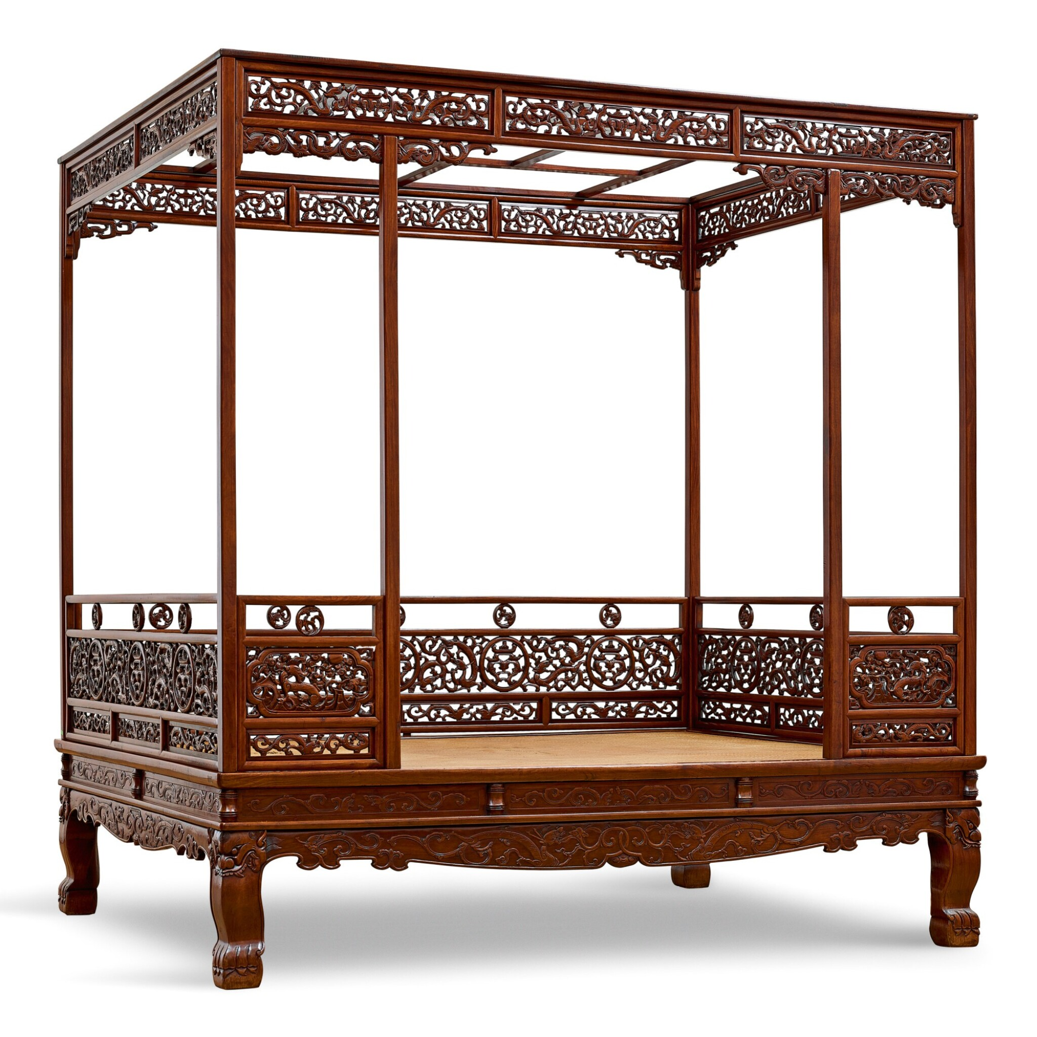 View full screen - View 1 of Lot 53. AN EXCEPTIONAL AND RARE HUANGHUALI SIX-POST CANOPY BED MING DYNASTY, 17TH CENTURY | 明十七世紀 黃花梨六柱透雕螭龍瑞獸紋圍子架子床.