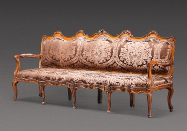 View 2. Thumbnail of Lot 177. A North Italian carved walnut sofa, probably Parma, mid-18th century.