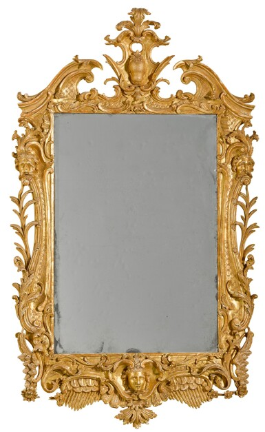 View 1. Thumbnail of Lot 67. A George II carved giltwood wall mirror, probably Irish, mid-18th century.
