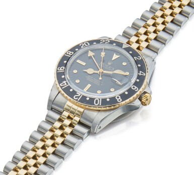 View 2. Thumbnail of Lot 24. ROLEX | GMT-MASTER REF 16753, A STAINLESS STEEL AND YELLOW GOLD AUTOMATIC DUAL TIME WRISTWATCH WITH DATE AND BRACELET CIRCA 1981.