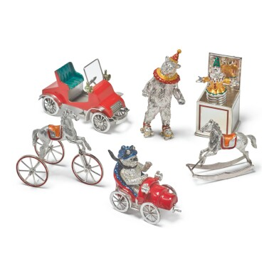 TOYS: A GROUP OF SILVER AND ENAMEL CIRCUS FIGURES, DESIGNED BY GENE MOORE FOR TIFFANY & CO., NEW YORK, CIRCA 1990