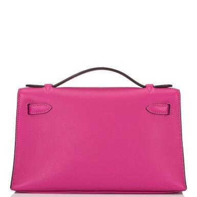 View 4. Thumbnail of Lot 15. Hermès Rose Pourpre Swift Mini Kelly Pochette.
