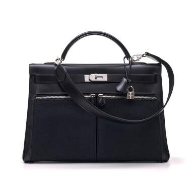 View 1. Thumbnail of Lot 332. Black Kelly Lakis 40cm in Toile and Box Leather with Palladium Hardware, 2008.