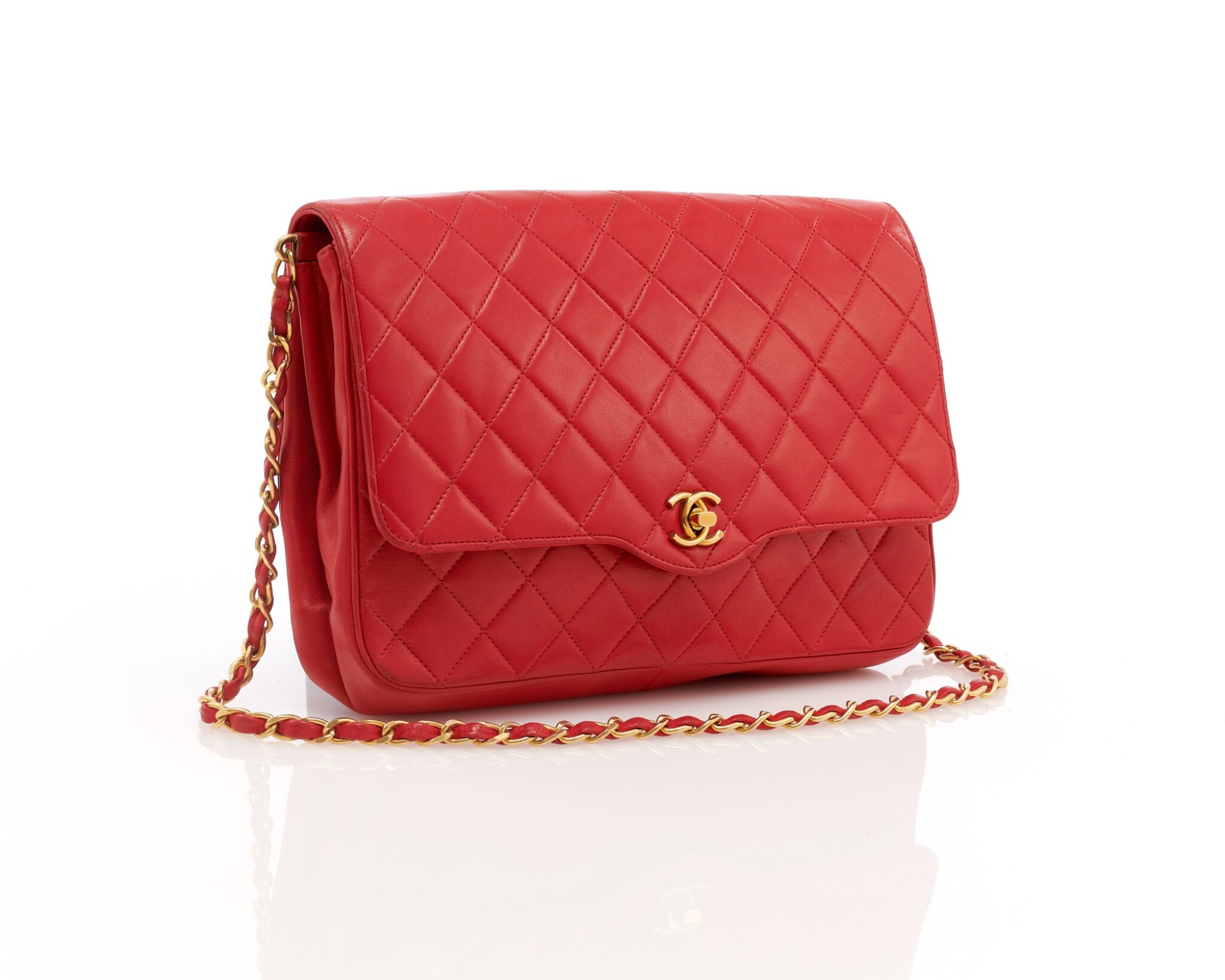 View full screen - View 1 of Lot 69. Red quilted leather and gold-tone metal chain shoulder bag.