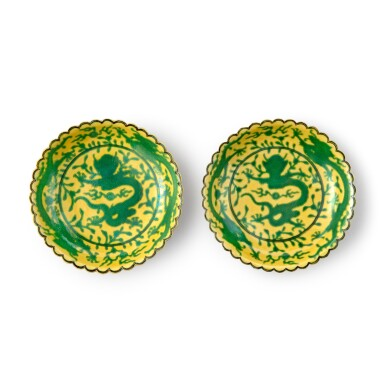 View 1. Thumbnail of Lot 71. A pair of yellow-ground green-enameled 'dragon' dishes, Seal marks and period of Qianlong | 清乾隆 黃地綠彩趕珠龍紋花口小盤一對 《大清乾隆年製》款.