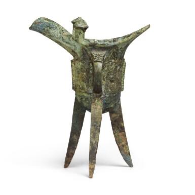 View 3. Thumbnail of Lot 5. An archaic bronze ritual wine vessel (Jue),  Late Shang dynasty | 商末 青銅饕餮紋爵.