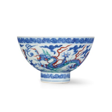 View 1. Thumbnail of Lot 3611. An extremely rare doucai and anhua-decorated 'dragon' bowl Mark and period of Zhengde | 明正德 鬪彩內暗花外雲龍紋盌 《正德年製》款.