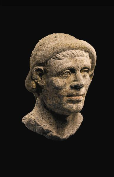 View 3. Thumbnail of Lot 37. AN ETRUSCAN NENFRO PORTRAIT HEAD OF A MAN, LATE 2ND/EARLY 1ST CENTURY B.C..