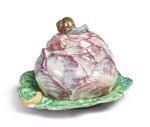 A CONTINENTAL FAIENCE RED-CABBAGE TUREEN AND COVER ON FIXED STAND, LATE 18TH CENTURY