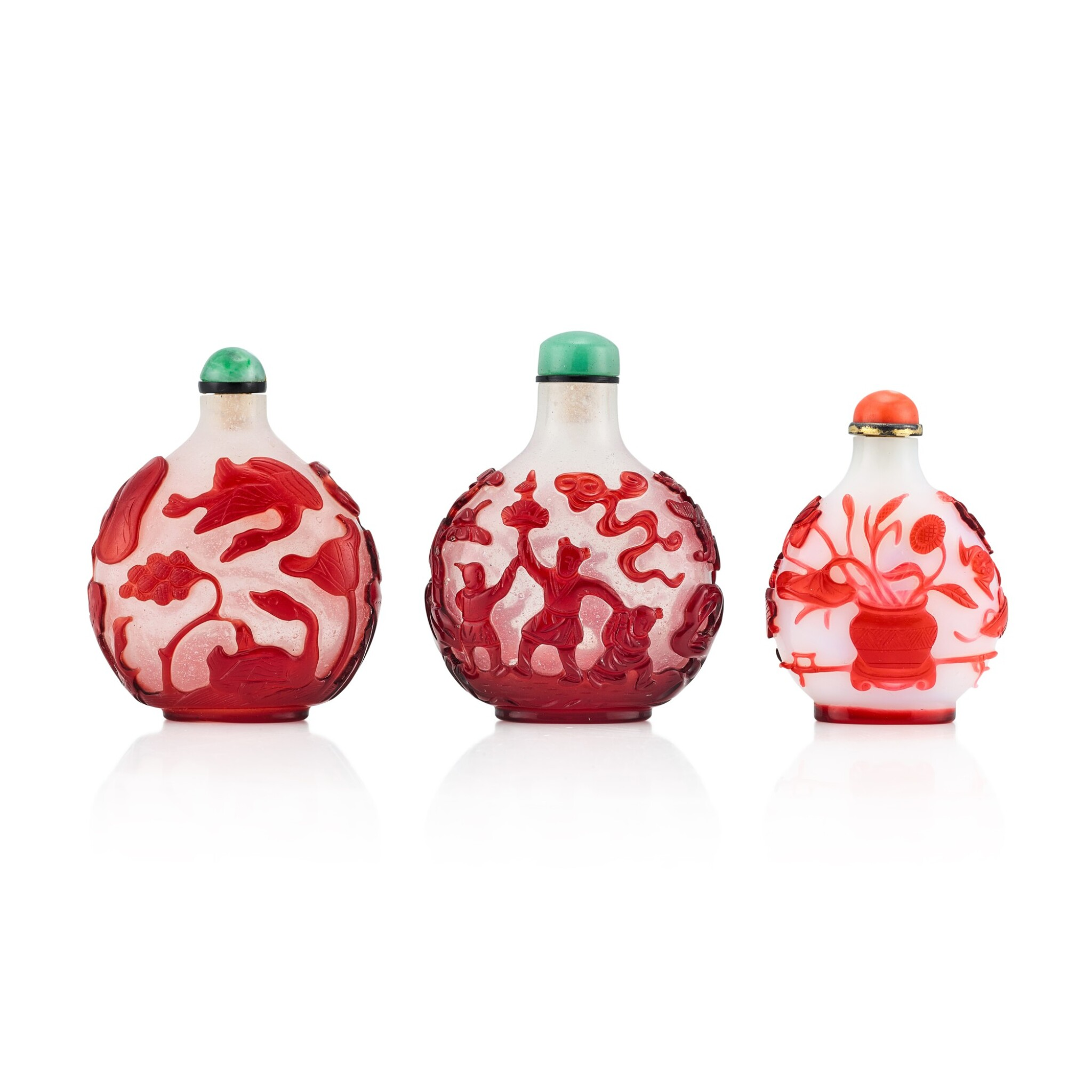 View 1 of Lot 3074. Three Ruby-Red Overlay Glass Snuff Bottles Qing Dynasty, 18th - 19th Century | 清十八至十九世紀 涅白與雪霏地套紅料鼻煙壺三件.