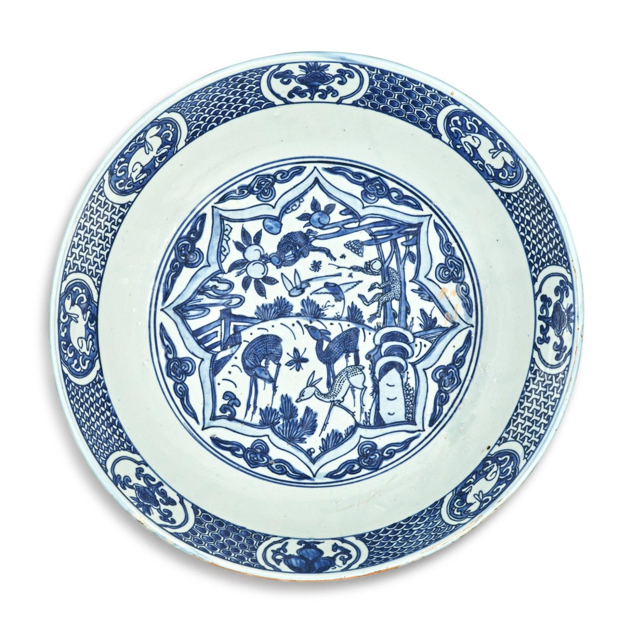 View full screen - View 1 of Lot 122. A large blue and white 'monkey and deer' dish, 16th / 17th century.