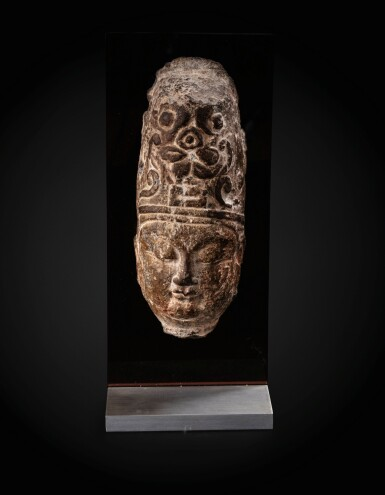 View 1. Thumbnail of Lot 23. An important fragmentary relief head of an attendant Sui dynasty-Tang dynasty, ca. 7th century   隋至唐 約七世紀 石浮雕神首殘件.
