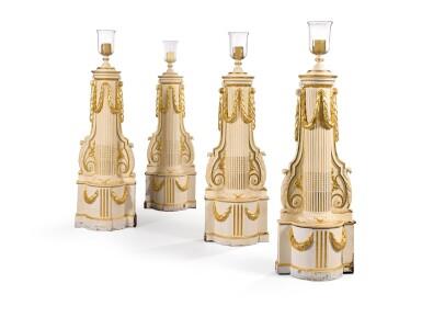 A SUITE OF FOUR PARCEL-GILT WHITE PAINTED COLUMNS WITH LAMPS BY GEORGES GEFFROY, CIRCA 1950, FOR ARTURO LOPEZ-WILLSHAW | SUITE DE QUATRE COLONNES FORMANT LAMPES EN BOIS SCULPTÉ LAQUÉ BLANC ET DORÉ PAR GEORGES GEFFROY, VERS 1950, POUR ARTURO LOPEZ-WILLSHAW