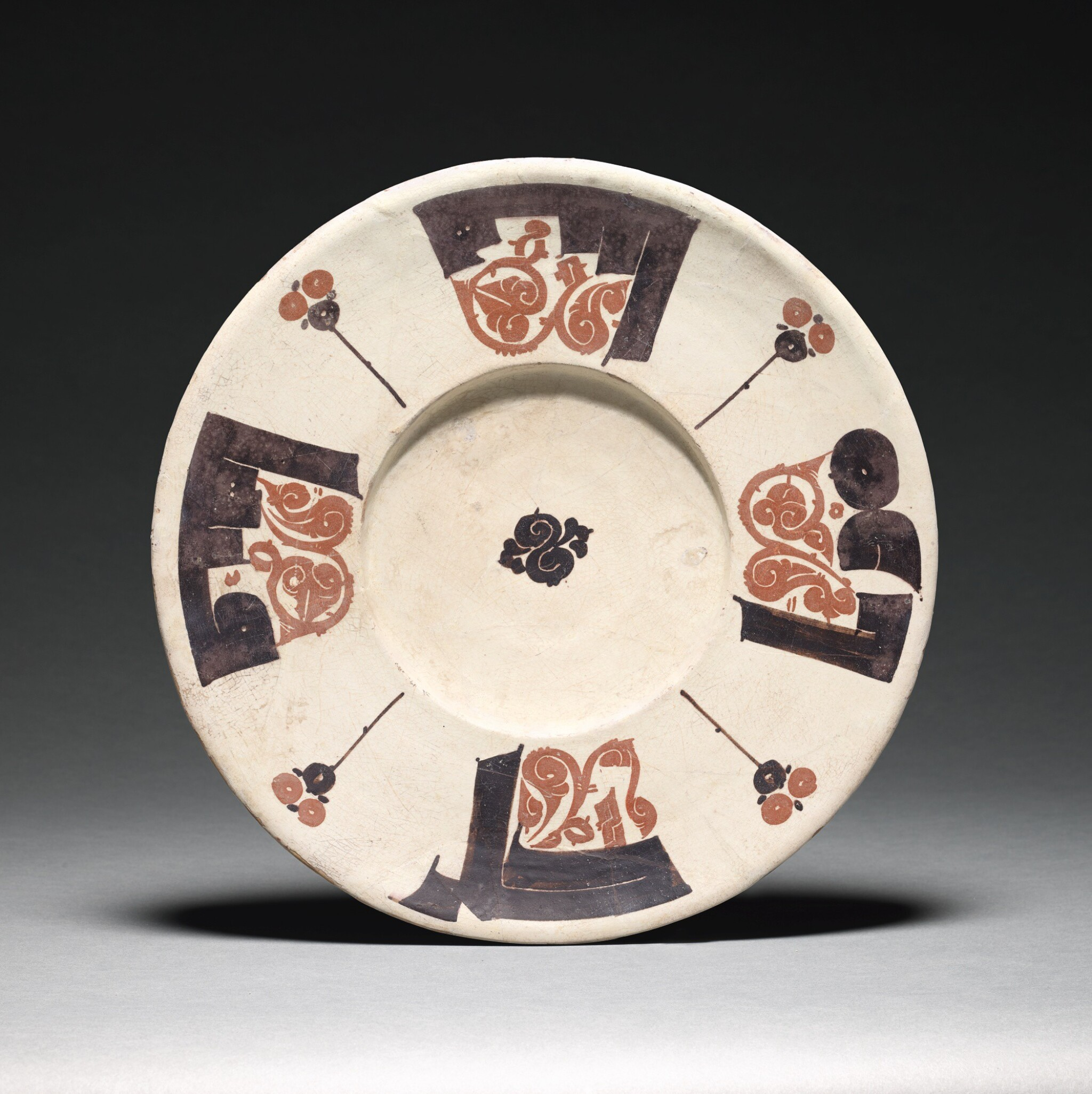 View full screen - View 1 of Lot 209. A RARE BICHROME CALLIGRAPHIC POTTERY DISH, NISHAPUR OR SAMARQAND, 10TH CENTURY.