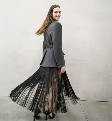View 1. Thumbnail of Lot 13. PRADA   OPENING LOOK OF THE SHOW.  FLUID FRINGE DRESS, WOOL JACKET, VANITY BELT, BRUSHED LEATHER PUMPS, WORN BY MEGHAN COLLISON.