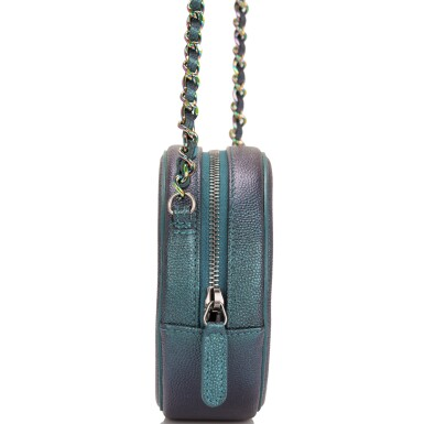 View 3. Thumbnail of Lot 118. Chanel Iridescent Dark Turquoise Caviar Round Mini Crossbody Bag.