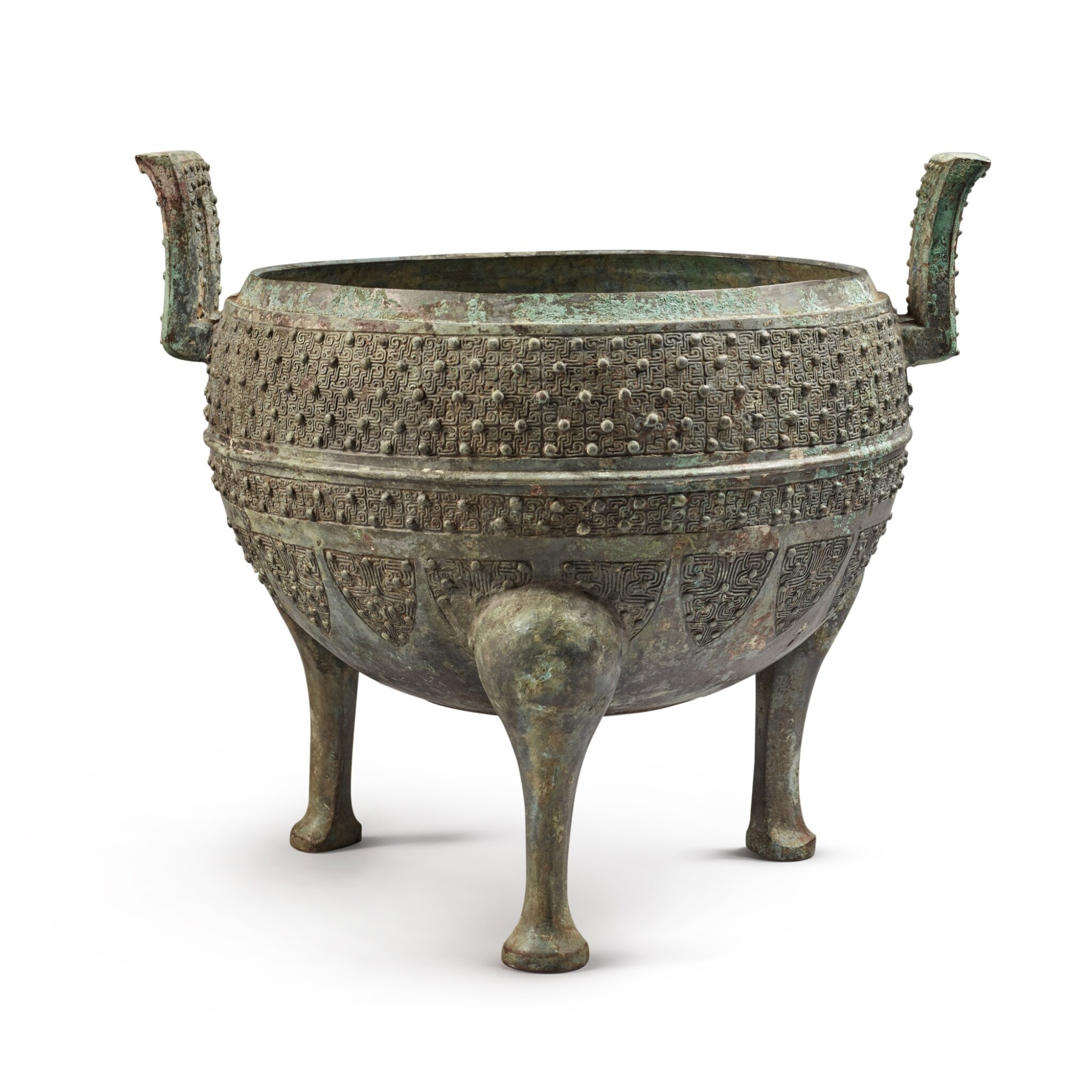 View full screen - View 1 of Lot 19. An archaic bronze food vessel (Ding), Eastern Zhou dynasty | 東周 青銅交龍紋鼎.