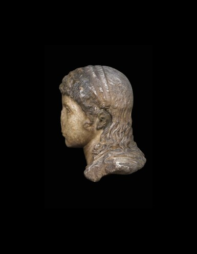 View 2. Thumbnail of Lot 66. A Roman Marble Portrait Head of a Boy, circa 2nd half of the 1st Century A.D..