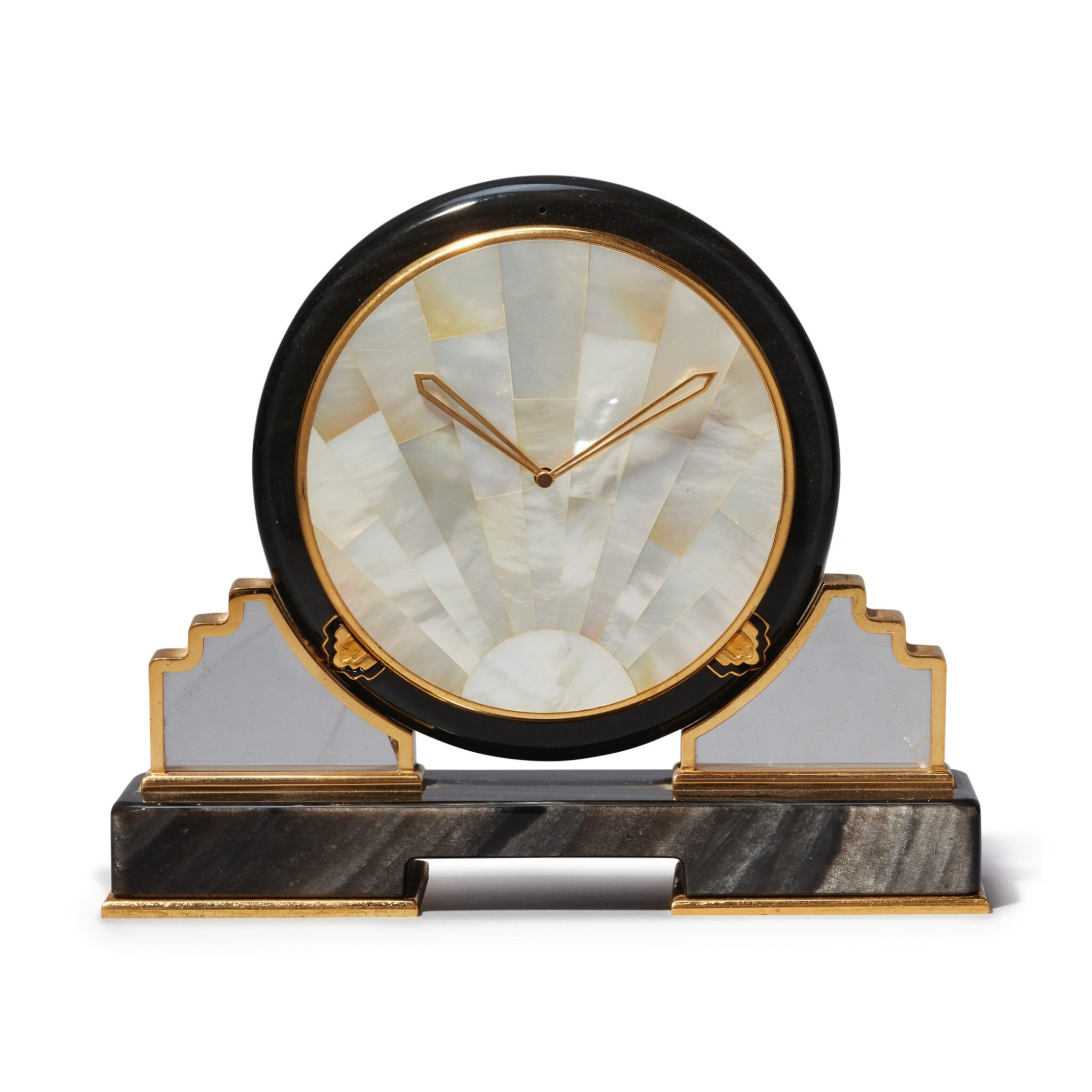 View full screen - View 1 of Lot 56. AN OBSIDIAN, MOTHER OF PEARL, ROCK CRYSTAL AND GILT BRASS DESK TIMEPIECE, CIRCA 1980.